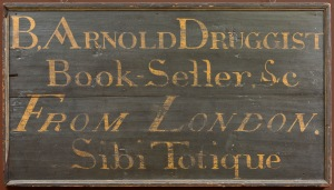"Photo: Benedict Arnold's Shop Sign, New Haven, c. 1760., New Haven Museum.  Benedict Arnold sold a variety of goods from his shop on George Street in New Haven. ""Sibi Totique"" on this original shop sign, loosely translated, means ""something for everyone."""