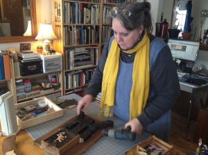 Diane Wright creates an assemblage in her studio